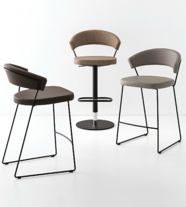 Padded stool with a New York sled base by Connubia Calligaris